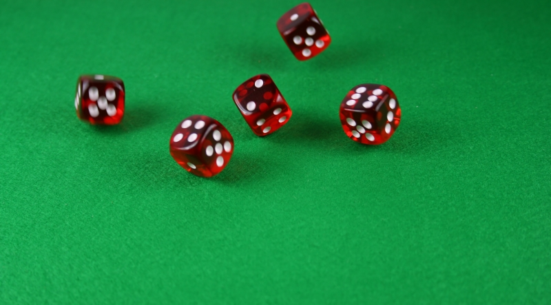 16871-an-action-shot-of-5-dice-thrown-onto-the-table